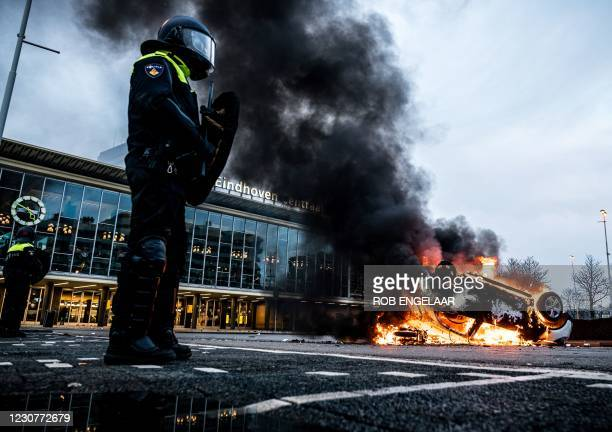 Car has been set on fire in front of the train station, on January 24, 2021 in Eindhoven, after a rally by several hundreds of people against the...