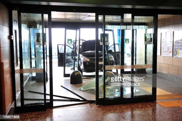 A car has broken a window of a terminal of Malpensa airport near Milan after a man smashed it into the terminal and was shot by a police officer...