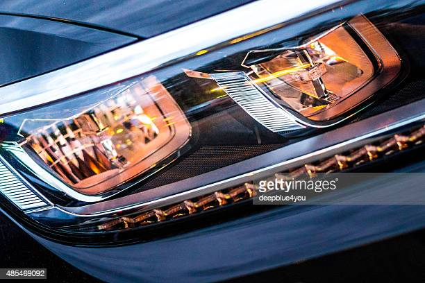car headlight  from new black vw vehicle - compact car stock photos and pictures