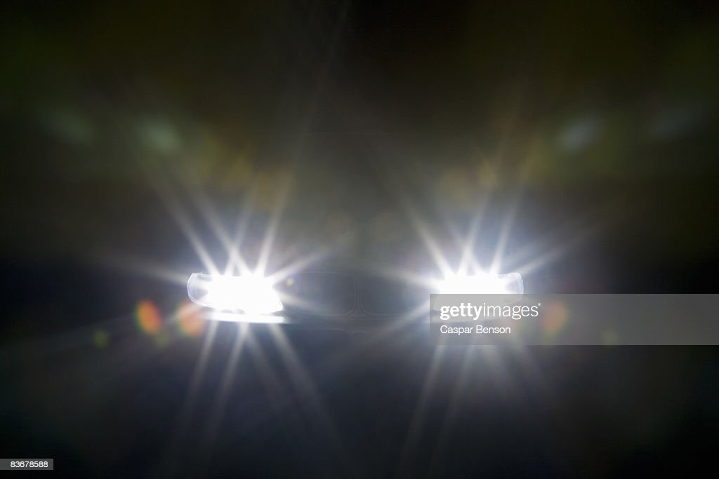 A car headlights illuminated at night : Stock Photo