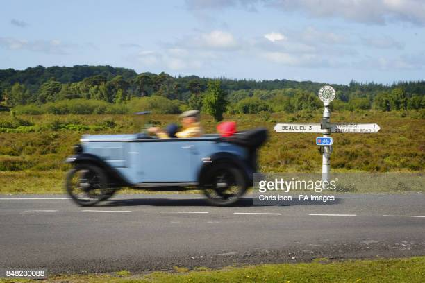 A car heads through the New Forest to the 50th Austin Seven rally at the National Motor Museum in Beaulieu Hampshire