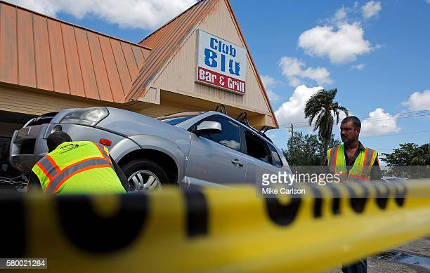 A car hit by gunfire is removed outside of Club Blu where two people were killed and at least 15 wounded on July 25 2016 in Fort Myers FloridaThree...