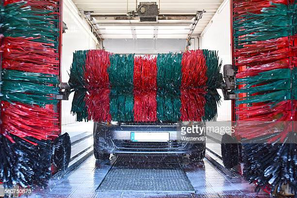 car in a car wash - car wash brush stock photos and pictures
