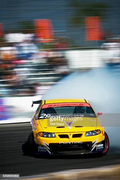 A car in a controlled skid at around 100mph at the round 1 season opener of the D1 Grand Prix at Irwindale Motor Speedway Drift racing originated in...