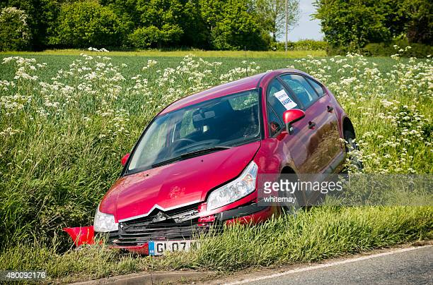 car in a rural ditch - ditch stock photos and pictures