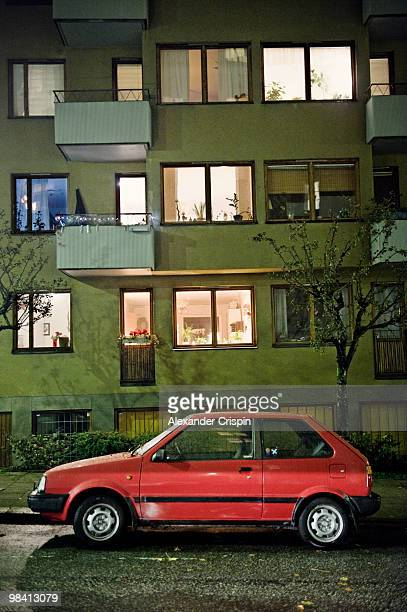 A car in front of a block of flats Sweden.