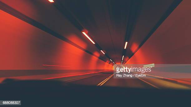 Car In Illuminated Tunnel Seen Through Windshield