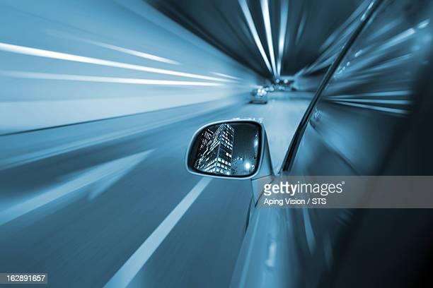 Car in motion on a Beijing road