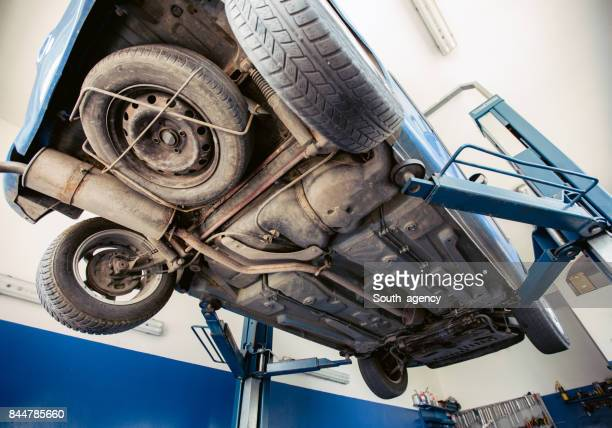 car in repair shop - chassis stock pictures, royalty-free photos & images
