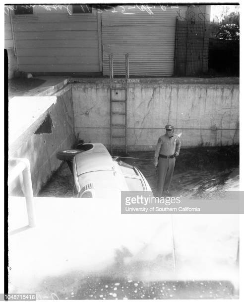 Car in swimming pool 3 November 1955 Officer RF BowmanCaption slip reads 'Daily Photographer Richardson Date Reporter Swaim Assignment Car in pool...