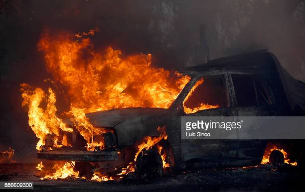 A car in the path of the Creek Fire is engulfed in flames near the intersection of Johanna Avenue and McBroom Street in Shadow Hills on Tuesday Dec 5...