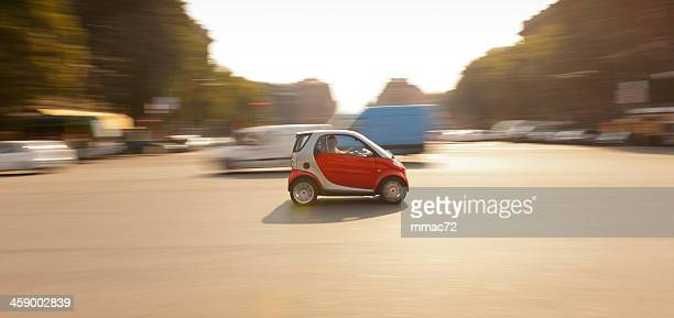 car in the streets of milan, italy - smart car stock photos and pictures