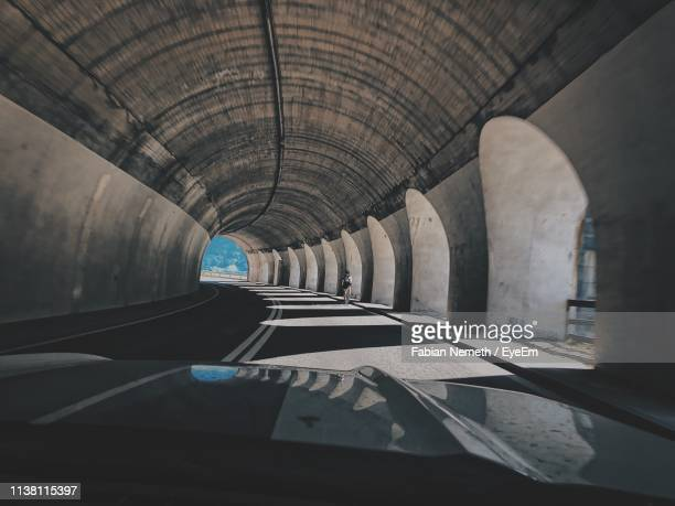 car in tunnel - arch architectural feature stock pictures, royalty-free photos & images