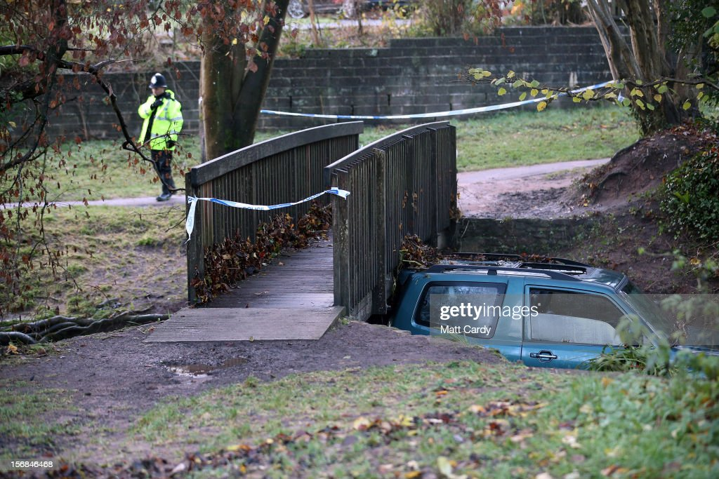 A car, in which a man died after being trapped in flood waters is wedged under a bridge near to a ford at Rectory Fields, in Chew Stoke, on November 23, 2012 in Somerset, England. The man died after becoming trapped in his 4x4 car in flood water last night as heavy rain continued to bring chaos to large parts of the country.