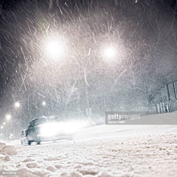 car in winter  - snow storm stock photos and pictures