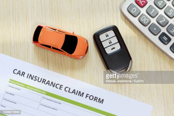 car insurance claim form with toy and key on table - car insurance stock pictures, royalty-free photos & images