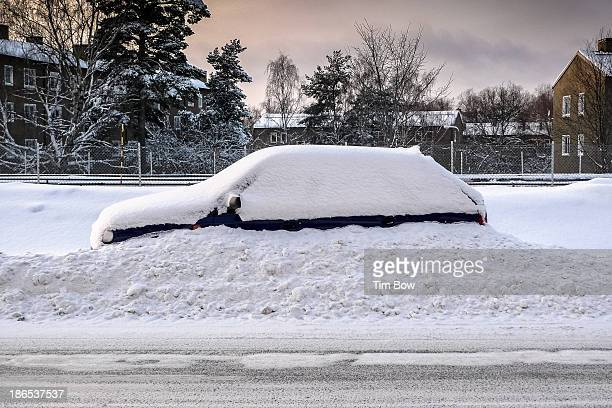 CONTENT] A car is barely visible in the snow after a night of heavy snowfall in a winter storm in a suburb of Stockholm Sweden