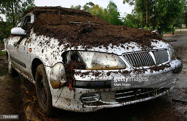 A car is covered in mud and debris after being submerged by a flash flood at Broughton Anglican College in Campbelltown on February 28 2007 in n...