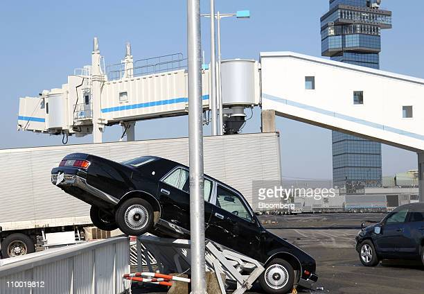 Car is damaged after the earthquake, at Oarai Port in Oarai town, Ibaraki prefecture, Japan, on Saturday, March 12, 2011. Japan awoke to images of...