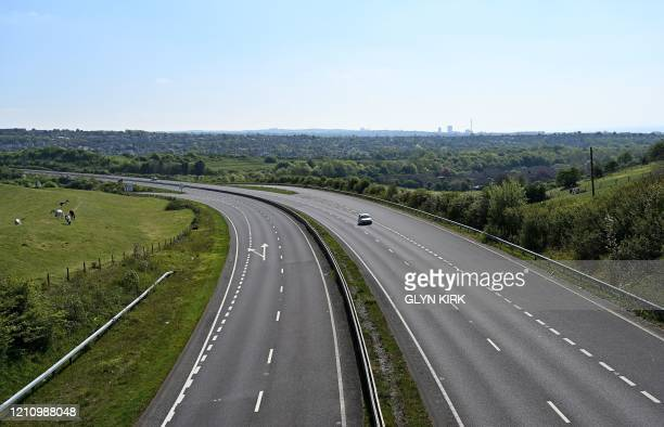 A car is driven on an empty A27 road near Brighton southern England on April 25 during the national lockdown due to the novel coronavirus COVID19...