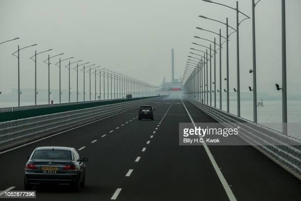 Car is driven towards Macau and Zhuhai on a section of the Hong Kong-Macau-Zhuhai Bridge on October 24, 2018 in Hong Kong, Hong Kong. The world's...