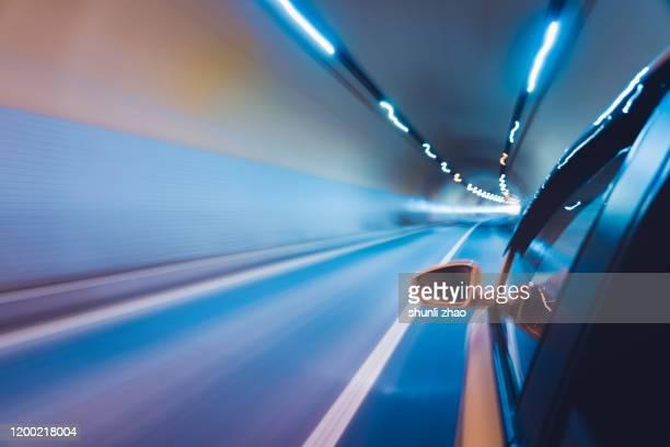 a car is driving in the tunnel - actuación conceptos fotografías e imágenes de stock