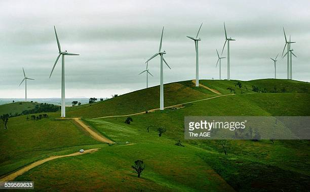 A car is dwarfed by giant generators at Pacific Hydro's Challicum Hills wind farm near Ararat the biggest such farm in the Southern Hemisphere It is...