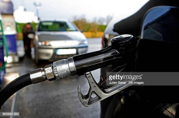 A car is filled up at a petrol station in CoLaois on Budget day when the Government has signalled it will introduce a carbon tax expected to raise...