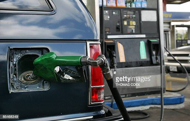 A car is filled with gasoline in a gas station on March 17 2009 in Caracas Venezuela Latin America's biggest oil producer is considering hiking its...