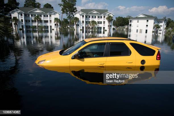 Car is inundated with floodwaters caused by Hurricane Florence at an apartment complex at Aberdeen Country Club on September 20, 2018 in Longs, South...