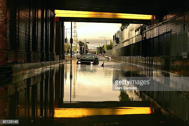 A car is left stranded under the railway bridge in Dudley Street West Melbourne on February 3 2005 after Melbourne receives wild weather in Melbourne...