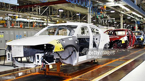 A car is manufactured on the assembly line before Chrysler Group and Fiat SpA CEO Sergio Marchionne announces the repayment of the remaining $59...