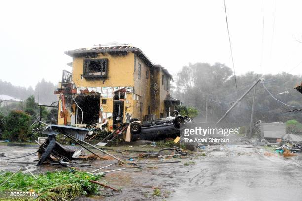 Car is overturned in front of damaged house believed to be blown off by a tornado triggered by Typhoon Hagibis on October 12, 2019 in Ichihara,...