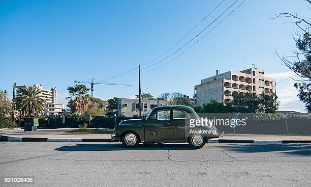 Car is parked in front of the walls that surround the Varosha quarter on January 5, 2017 in Famagusta, Cyprus. Prior to the Turkish invasion of...