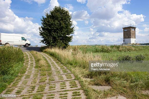 A car is passes by the former border the line of the Iron Curtain between East and West Germany The German Democratic Republic or East Germany was a...
