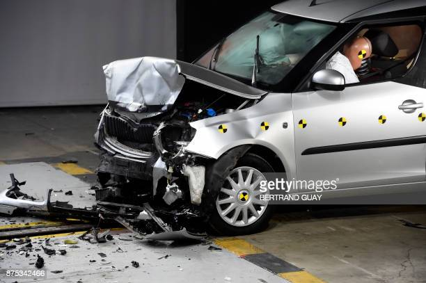 A car is pictured after a frontal crash test with another car without a safety belt buckled in the back seat as part of France's Road Safety...