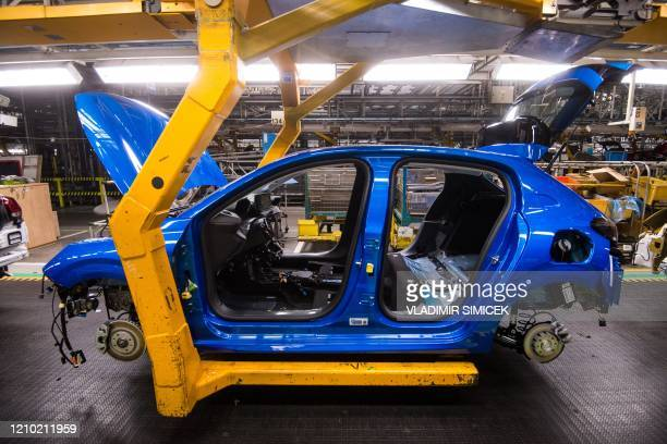 Car is pictured at the assembly line at the PSA Peugeot Citroen plant in Trnava, Slovakia on April 17, 2020. - PSA Peugeot Citroen plant in Trnava...