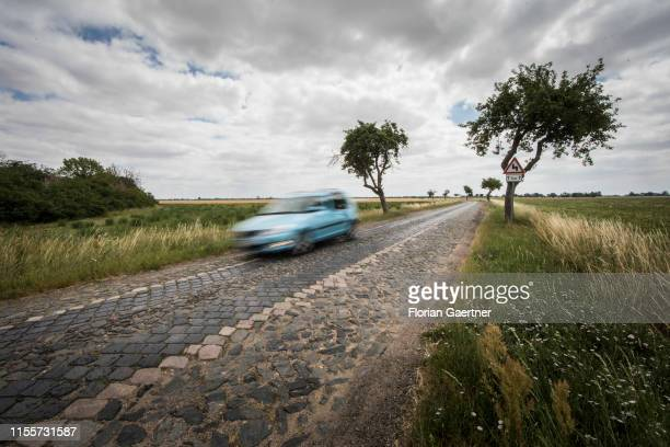A car is pictured on a bad country road on June 28 2019 in Packisch Germany