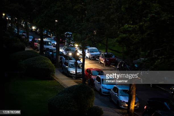 Car is pictured on a street full of parked cars during blue hour on September 28, 2020 in Berlin, Germany.