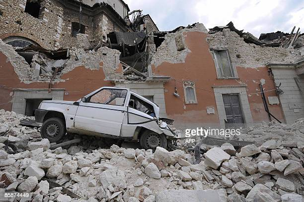 "Car is pictured on April 9, 2009 in the rubble of the provincial government headquarters, ""Palazzio del Governo"", on the Abruzzo capital L'Aquila...."