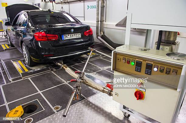 A car is prepared for standard emissions testing under laboratory conditions during a workshop for media on automobile emissions at the DEKRA testing...