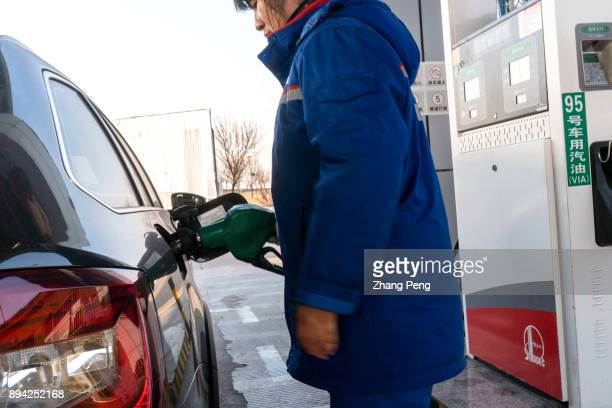 A car is refueling in a gas station Recently many media reports said that China has launched a timetable for stopping production and sale of...