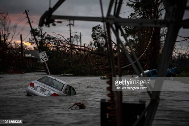 A car is seen caught in flood water after category 4 Hurricane Michael made land fall along the Florida panhandle on Wednesday Oct 10 2018 in Panama...