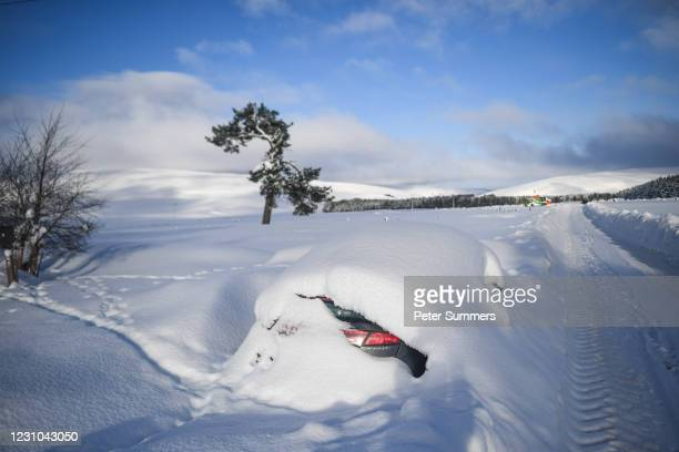 Car is seen covered in snow on February 8, 2021 in Cabrach, United Kingdom. Heavy snow in Scotland and South East England over the weekend kick...