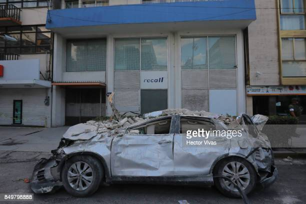A car is seen destroyed after the magnitude 71 earthquake that jolted central Mexico damaging buildings knocking out power and causing alarm...