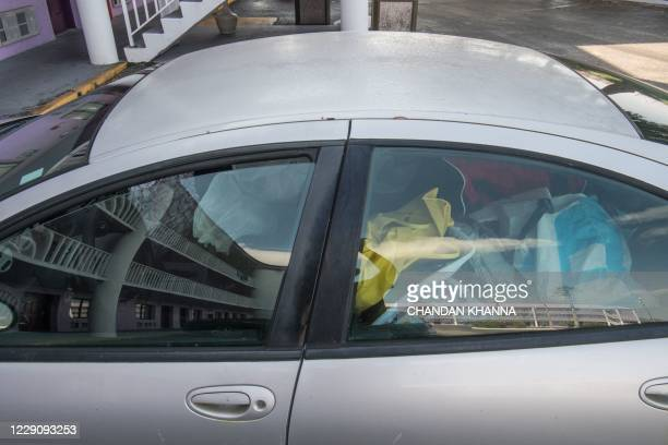 Car is seen full of household items at the parking lot of The Magic Castle Inn in Kissimmee, Florida on October 15, 2020. - Labor Department data...