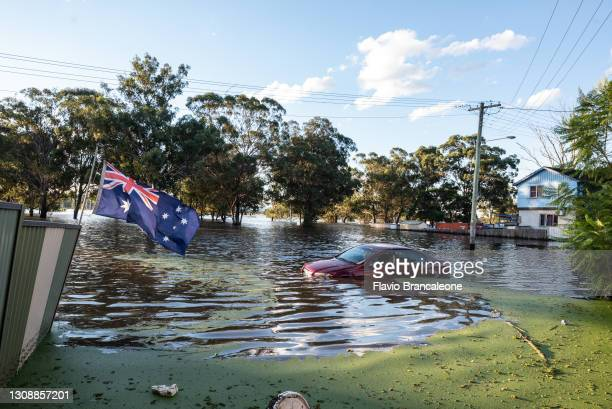 Car is seen half submerged in the flood on March 24, 2021 in Sydney, Australia. Recovery and flood clean up begins for parts of Western Sydney...
