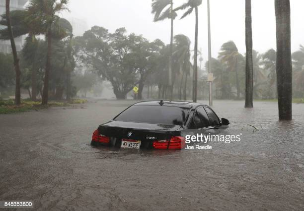 A car is seen in a flooded street as Hurricane Irma passes through on September 10 2017 in Miami Florida Hurricane Irma made landfall in the Florida...