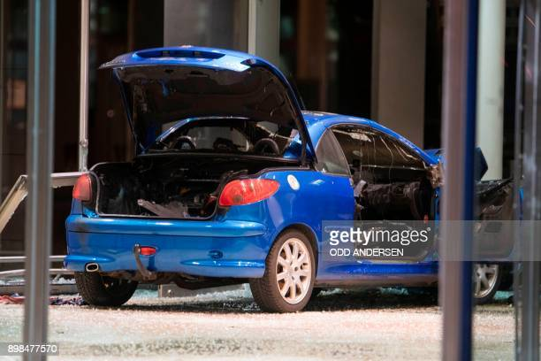 A car is seen in the lobby of the German Social Democratic Party headquarters after a vehicle was used to ram the building in Berlin early December...