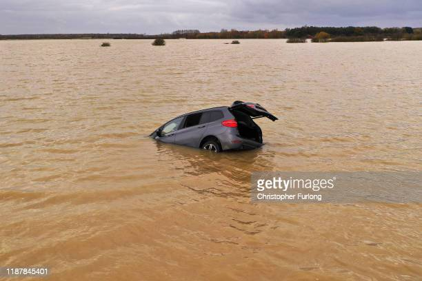 A car is seen part submerged in floodwater at Bardney near Lincoln after the Barlings Eau broke its banks on November 15 2019 in Lincoln England Over...